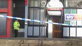 Death: Area outside pub cordoned off.
