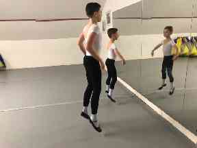 Aidan and Matthew practising their ballet moves.