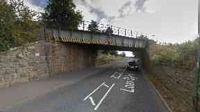 Crash: Hillside railway bridge struck in crash.