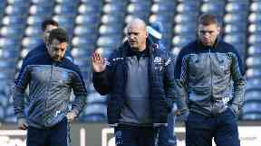 Plan: Gregor Townsend talks with Greig Laidlaw (left) and Finn Russell (right) at Murrayfield Stadium.
