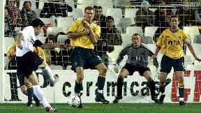 Effort: David Albelda strikes the ball towards Celtic's goal.