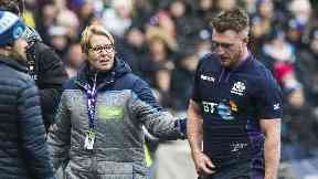 Shoulder: Stuart Hogg leaves the field during Scotland's defeat to Ireland.