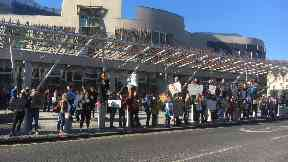 Demonstration: Pupils gathered at the Scottish Parliament last month.
