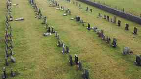 Felled headstones at St Peter's graveyard on Orkney.