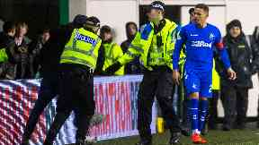 Pitch invader: Rangers captain James Tavernier looks on.