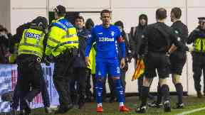 Flashpoint: Police tackle a pitch invader who confronted James Tavernier.