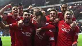 Aberdeen players celebrate Connor McLennan's goal.