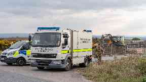 Bomb squad: The 'old war unit' was removed from the scene.