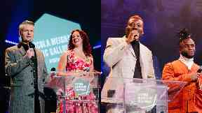 Awards: Hosts Vic Galloway and Nicola Meighan alongside previous winners Young Fathers.