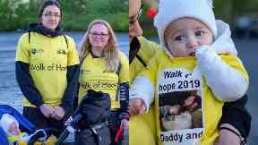 Heartbroken: Laura D'Arcy and baby Lewis took part in the Walk of Hope.