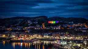 Spectacular: McCaig's Tower shines brightly in the LGBT colours.