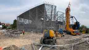 Protection: Construction workers erecting the steel frame.