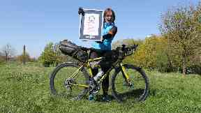 Jenny Graham shows off her world record certificate.