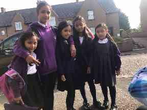 Kolsuma (second left) is heading to high school.