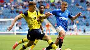 Rangers: Oxford's Josh Ruffels challenges Greg Docherty.