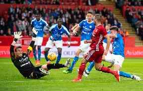Goal: McGinn fires Aberdeen in front.
