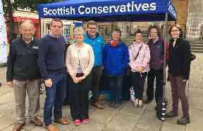 Campaigning: Ms Lax (far right) out with Moray MP Douglas Ross (second left).