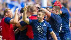 Joy: Greig Laidlaw salutes the crowd as Scotland take the lead at Murrayfield.