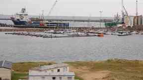 Ten rescued after seven dinghies capsize at harbour