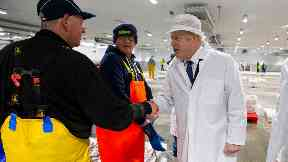 Boris Johnson joined in an auction at the fish market.