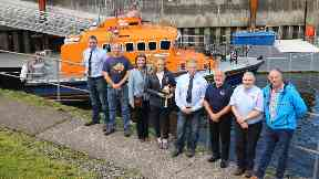 Celebration: Kerrie MacGillivray was handed the commemorative bell by RNLI Oban's volunteer lifeboat crew.