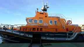 Rescue: A pensioner fell into harbour waters.