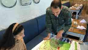 Sanjay Narang and his sister Rachna study their plans.