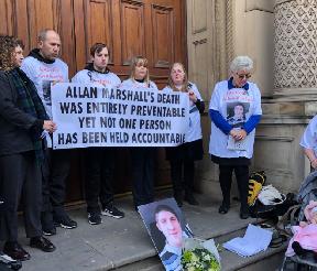 Vigil: Allan Marshall's family.