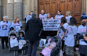 Vigil: Family outside crown office.