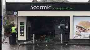 Targeted: The front of the Scotmid store was smashed in.