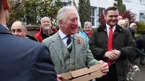 Royal: Prince Charles enjoys a Borders pizza