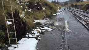 Heavy flooding has forced the rail line's closure.