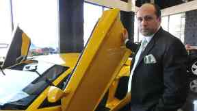 Afzal Khan is accused of running a luxury car scam.