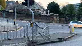 Edinburgh: The safety railing at the pedestrian crossing was damaged.