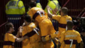 Thriller: Motherwell players celebrate injury time equaliser