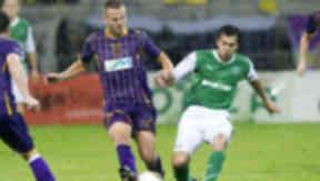 European blow: Dalibor Volas with Hibs' Ian Murray.