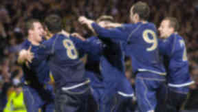Barry Ferguson: The former Rangers and Scotland skipper celebrates a goal against then world champions Italy.