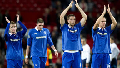 Praise: Rangers players applaud fans following 0-0 draw with Manchester United