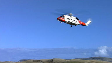 Coastguard rescue helicopter: standing by at Rum