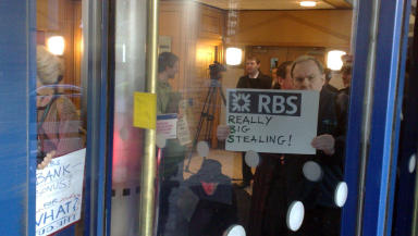 Angry: Protesters inside the RBS-owned building