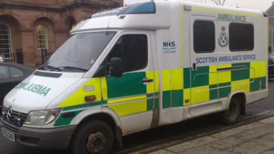 Ambulance: Hospital staff had to pull patient off paramedic.