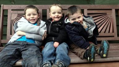 Fundraising artist: Jack Henderson with his brothers Toby and Noah.