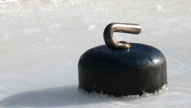 Curling stone: Former champ sues national coach over remarks.