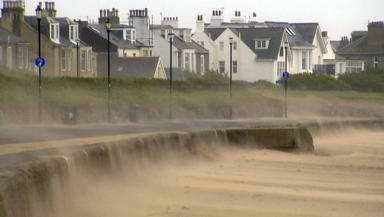 Blown away: Trains and ferries were cancelled and roads blocked.