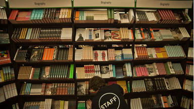 Staff organise books at last year's Festival Bookshop