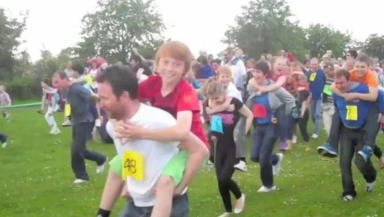 Success: The piggy back race in June has smashed the previous world record.