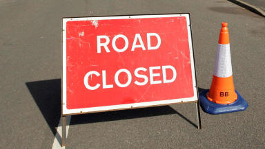Road closed police emergency accident sign