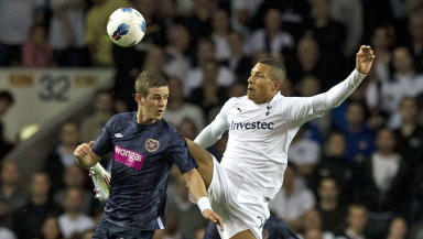 David Templeton of Hearts battle Jake Livermore of Tottenham Hotspur in the Europa League