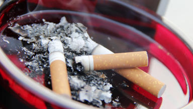Smoking cigarettes in ashtray close quality image