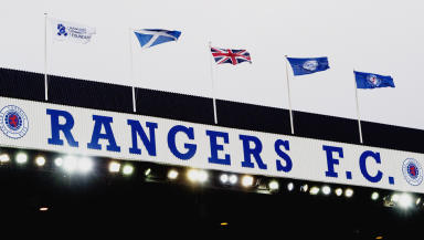 Quality shot of Rangers sign inside Ibrox stadium with flags flying.